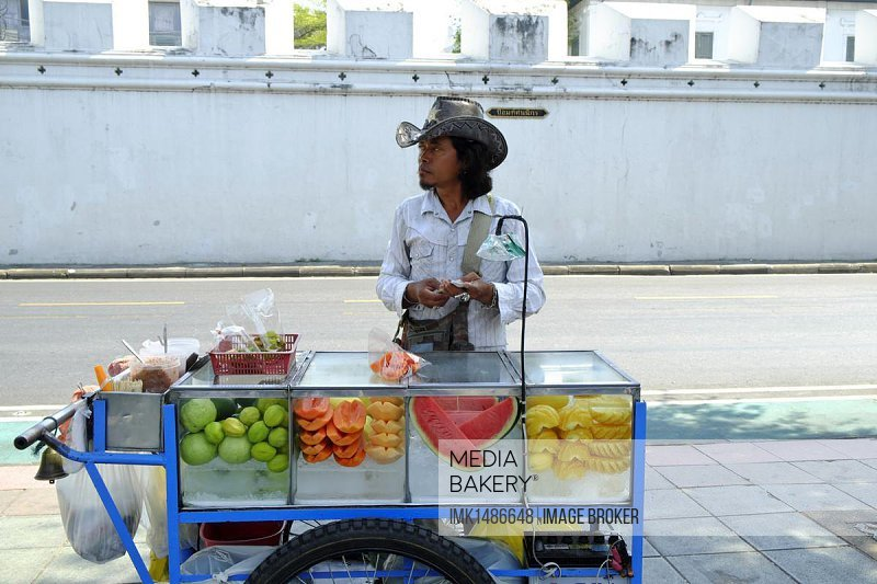 Street vendor with fresh fruit, fruit seller, Bangkok, Thailand, Asia