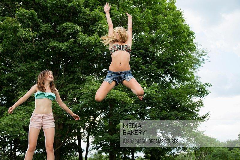Girls in bikinis on trampolines 5