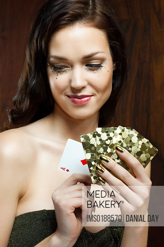 Young woman playing cards