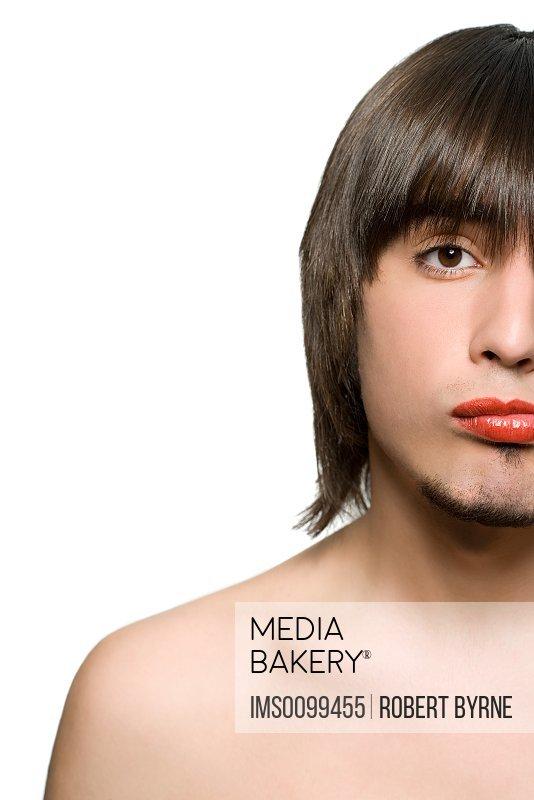 Young man wearing lipstick