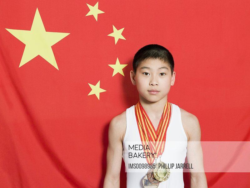 Boy with chinese flag and medals