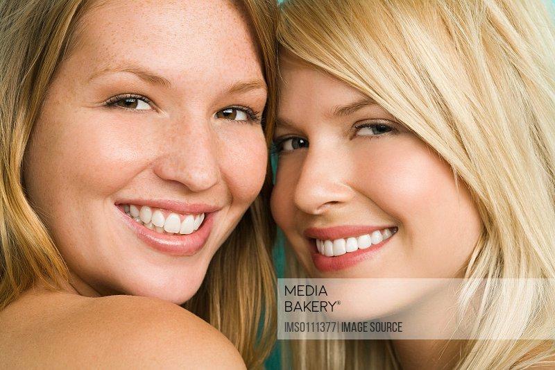 Two smiling blonde women