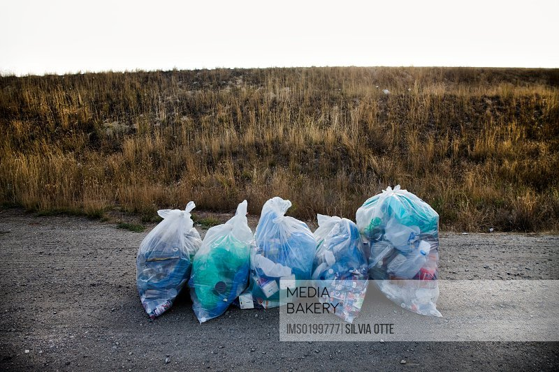 Recycling bags on a road