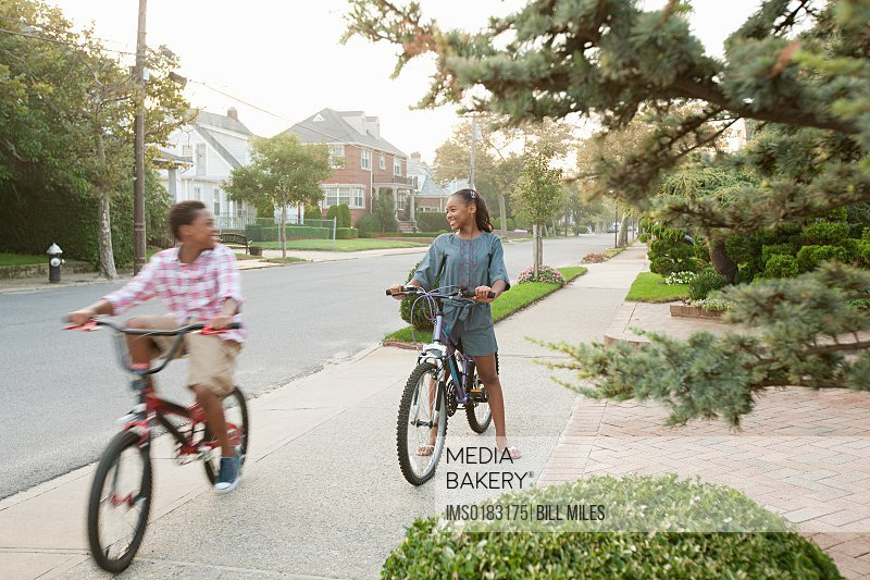 Brother and sister on bicycles