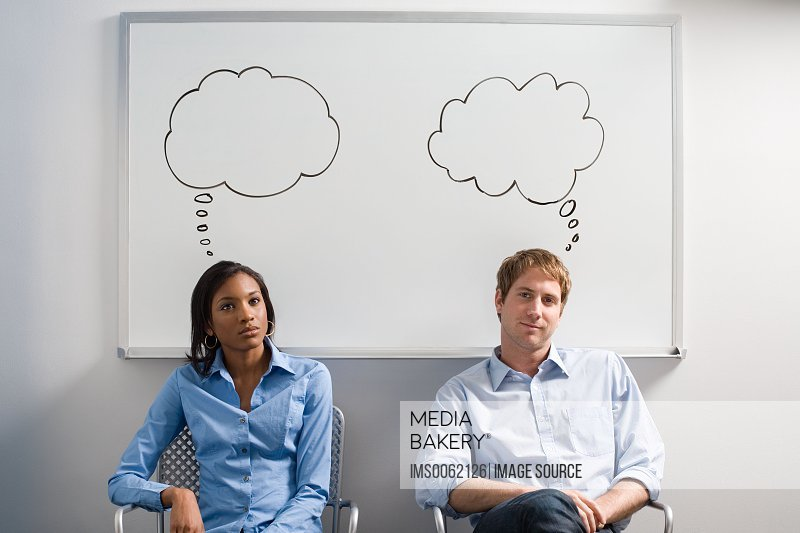 Office workers with thought bubbles