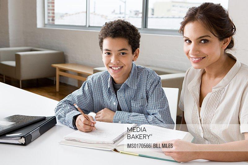 Woman mentoring boy