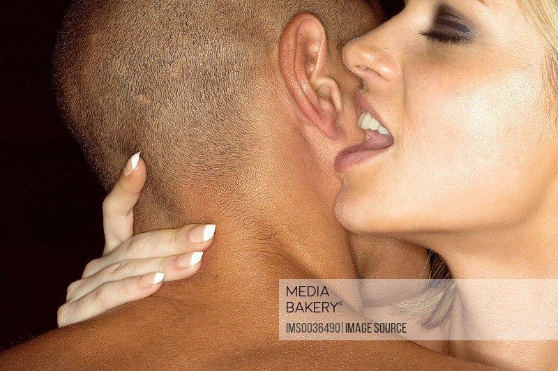 Woman whispering in mans ear