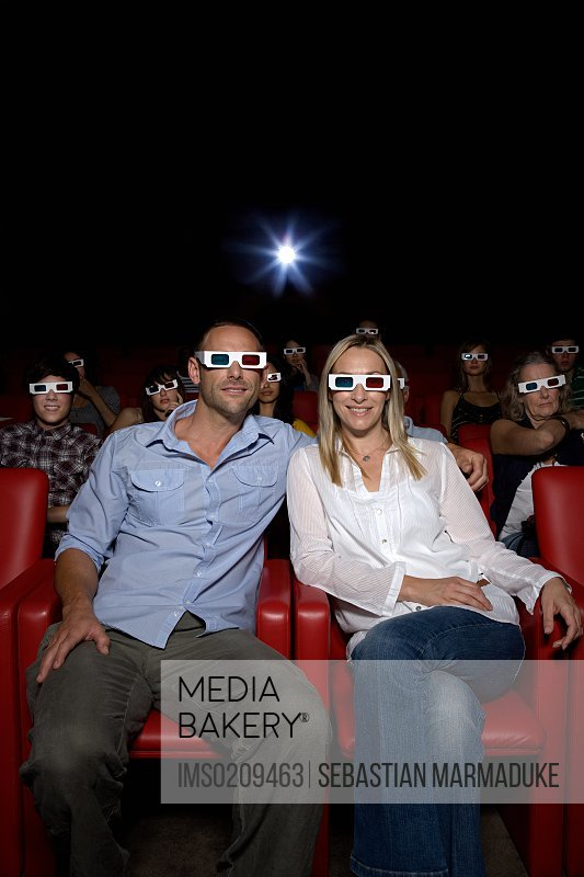 Mid adult couple in movie theater