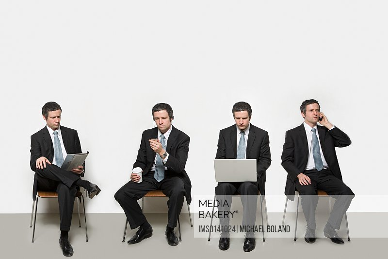 Businessmen with different objects