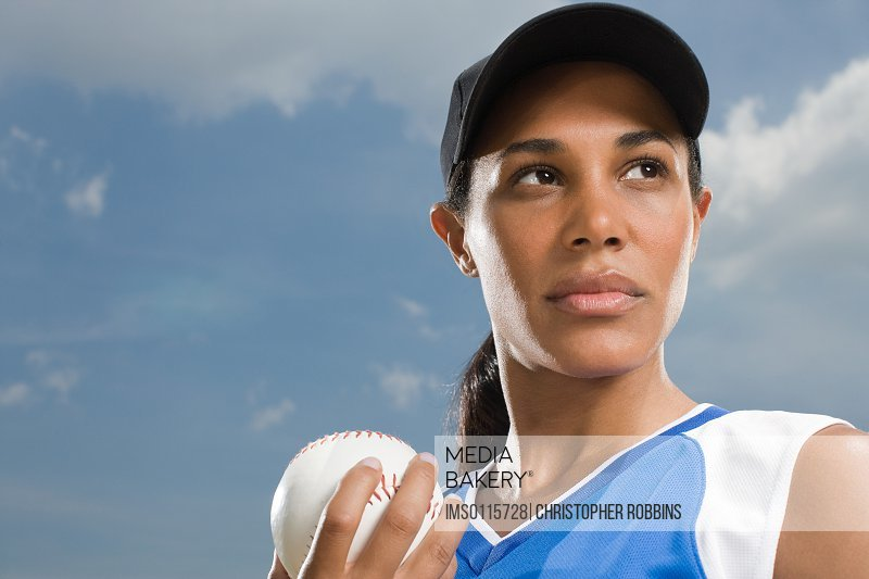 Woman holding baseball