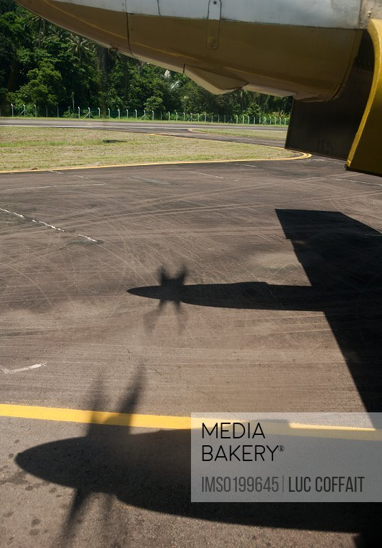 Airplane and shadows of propellers