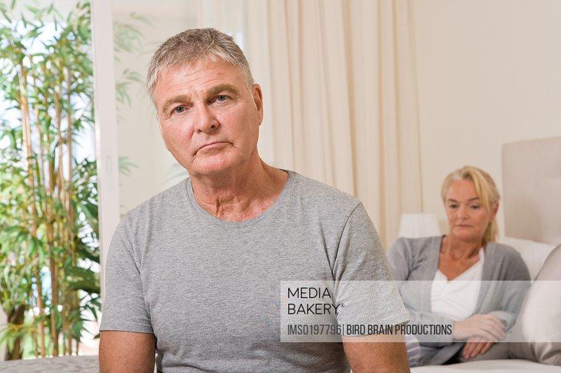 Worried couple in bedroom