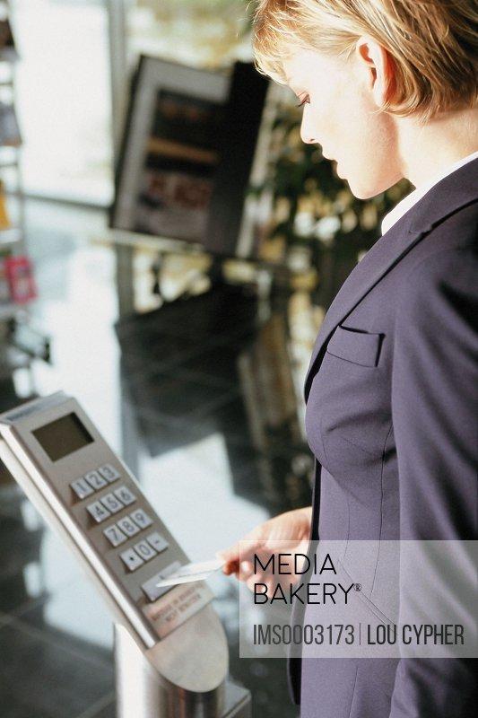 Businesswoman entering security pass