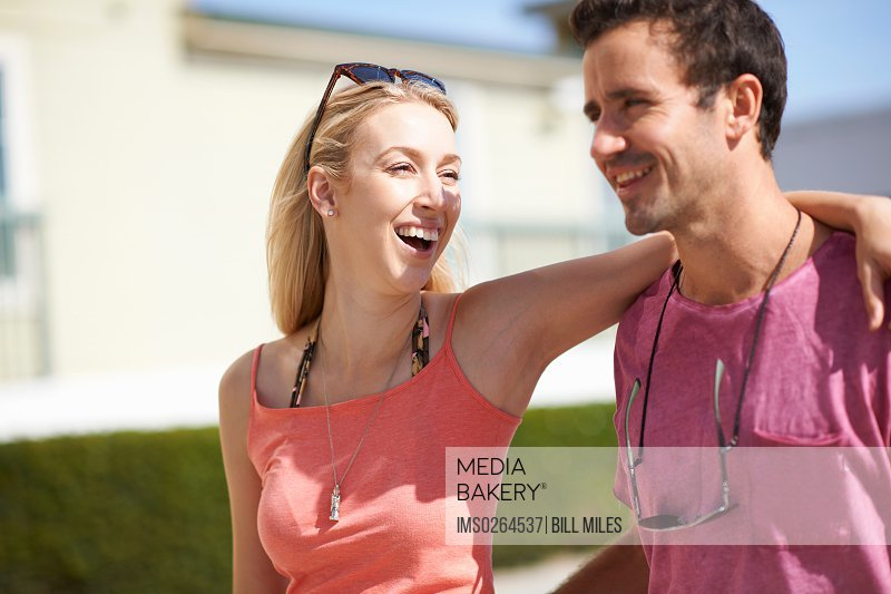 Couple walking outdoors laughing