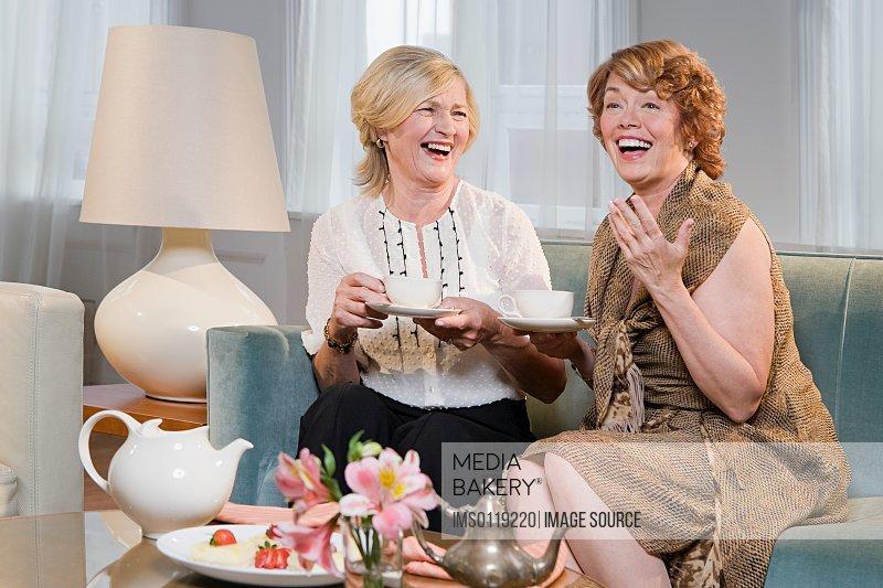 Women laughing and having tea