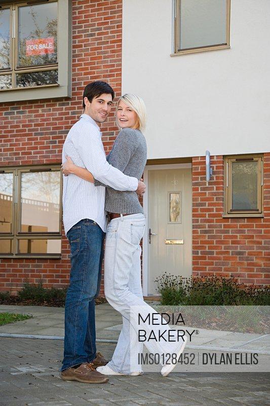 Couple outside new house