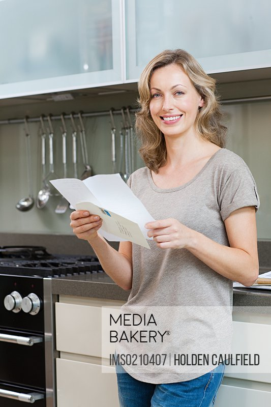 Mature woman holding letter