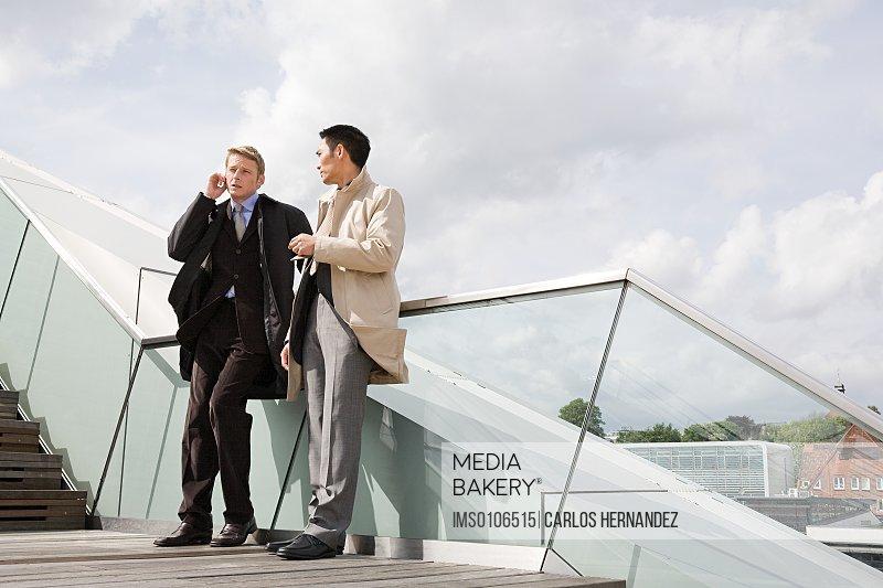 Businessmen standing on a stairway