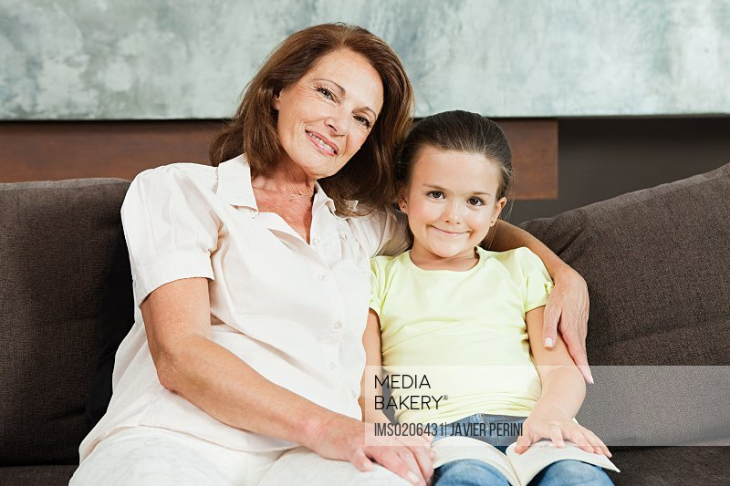 Grandmother and granddaughter with book