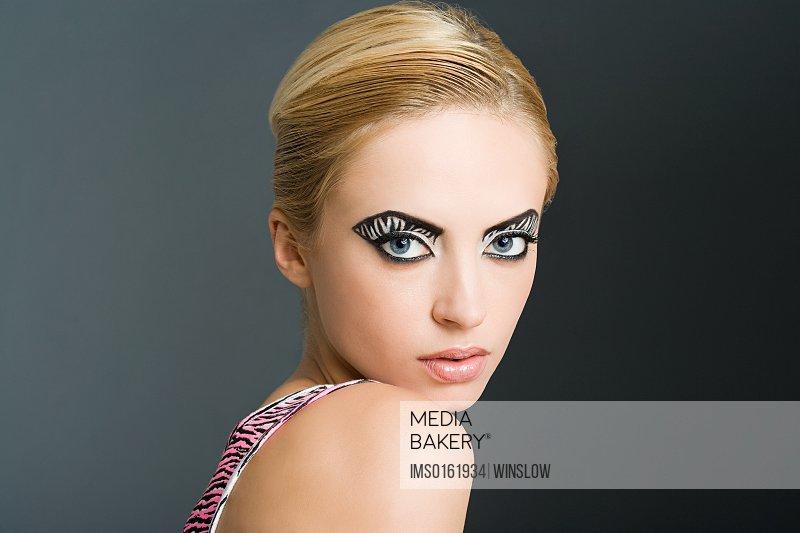 Woman with zebra stripe eye makeup