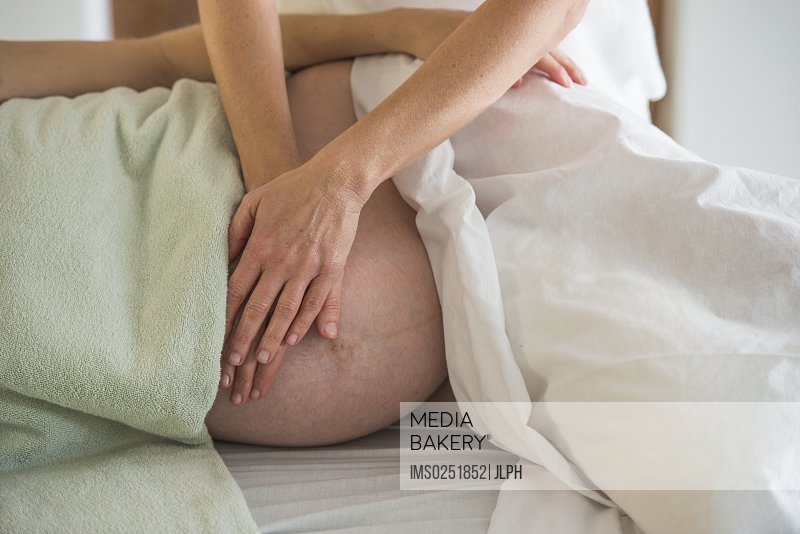 Woman having prenatal massage