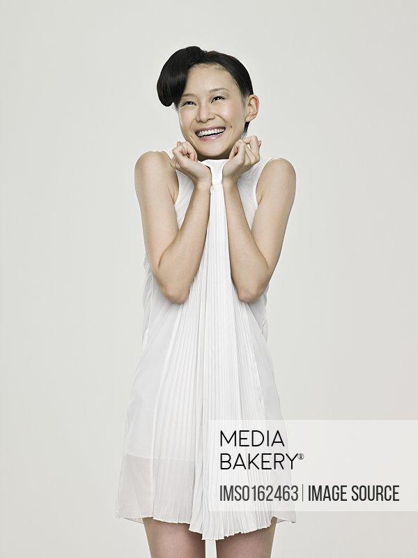 Cute asian woman laughing