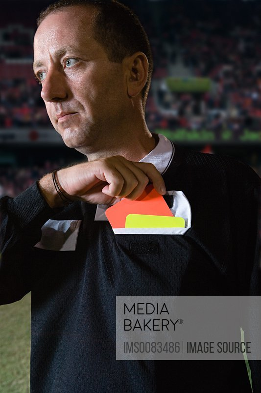 Referee holding red card