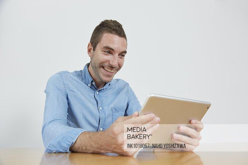 Caucasian man using tablet