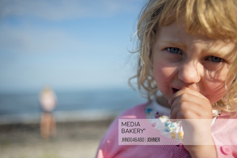 Girl with thumb in mouth Osterlen Ystad Skane Sweden
