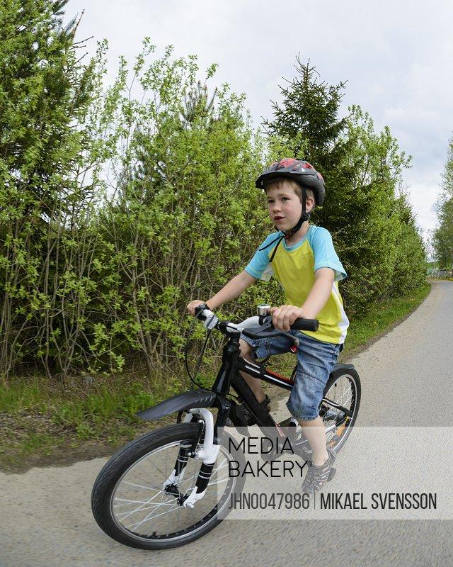 Boy cycling Molndal Vastergotland Sweden