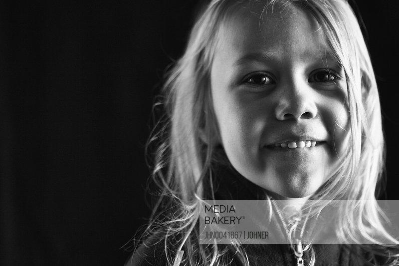 Portrait of smiling girl studio shot