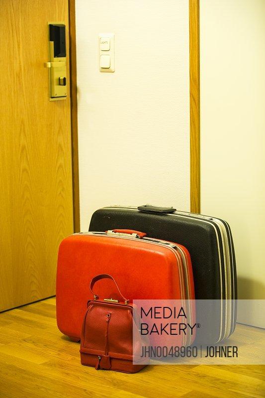 Suitcases near entrance door