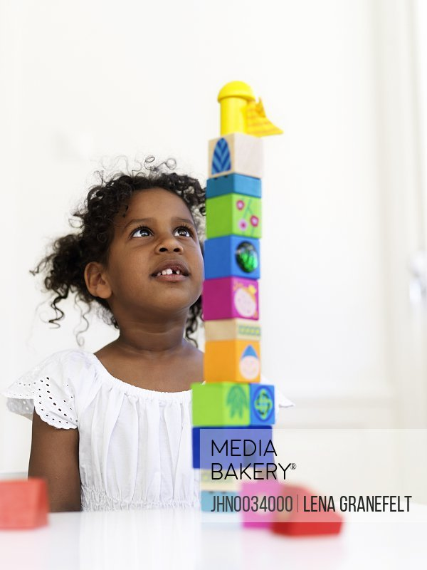 Girl building tower out of bocks