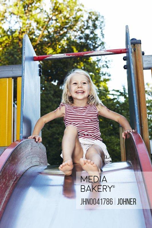 Girl on playground slide Sweden