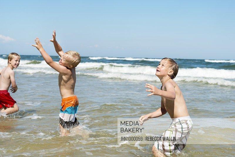 Boys playing in sea