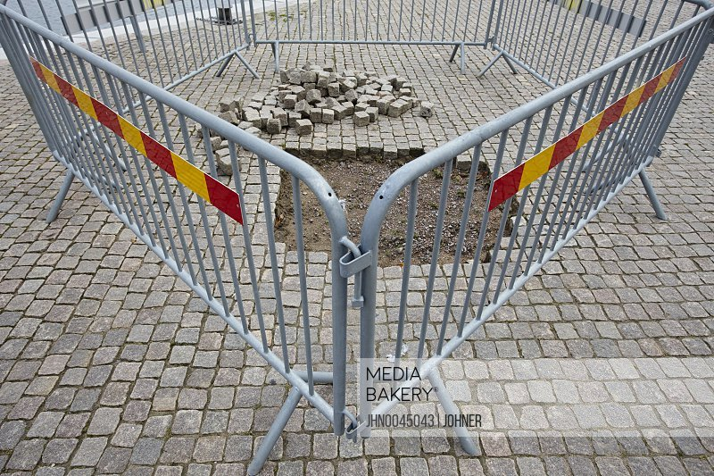 Fence around hole in pavement Marstrand Bohuslan Sweden