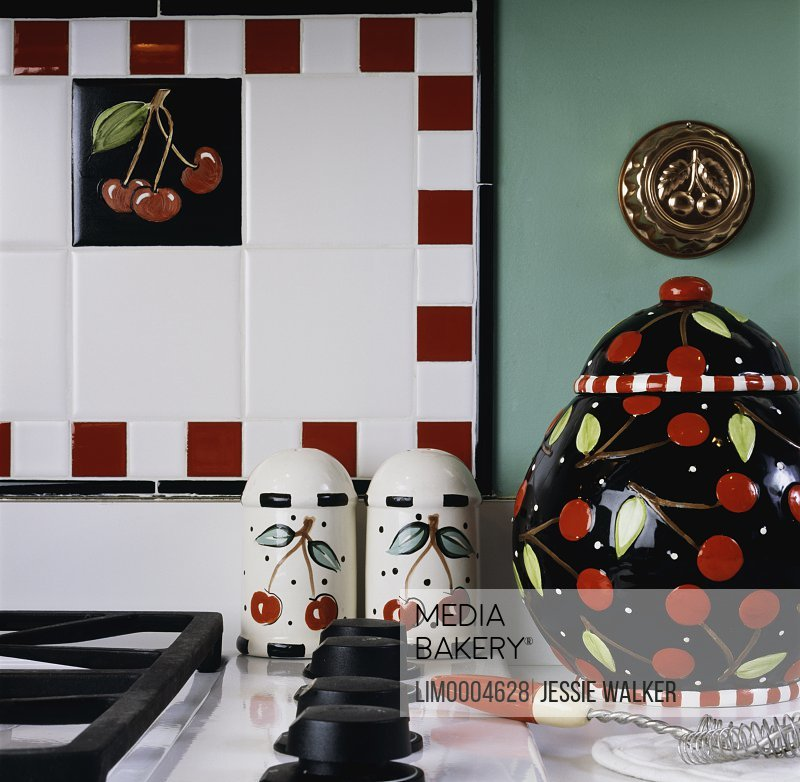 Mediabakery Photo By Lived In Images Kitchen Details Cherry Theme Covered Cookie Jar Salt And Pepper Copper Mold Painted Tile Red Black White Green Walls