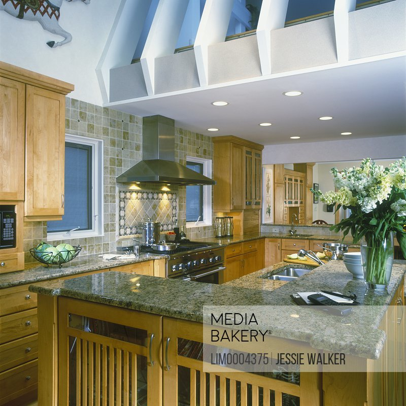 With Granite Counter Tops Stainless Steel Liances Stock Flowers Vased Recessed Lighting Tumbled Marble Tile Wall Photo