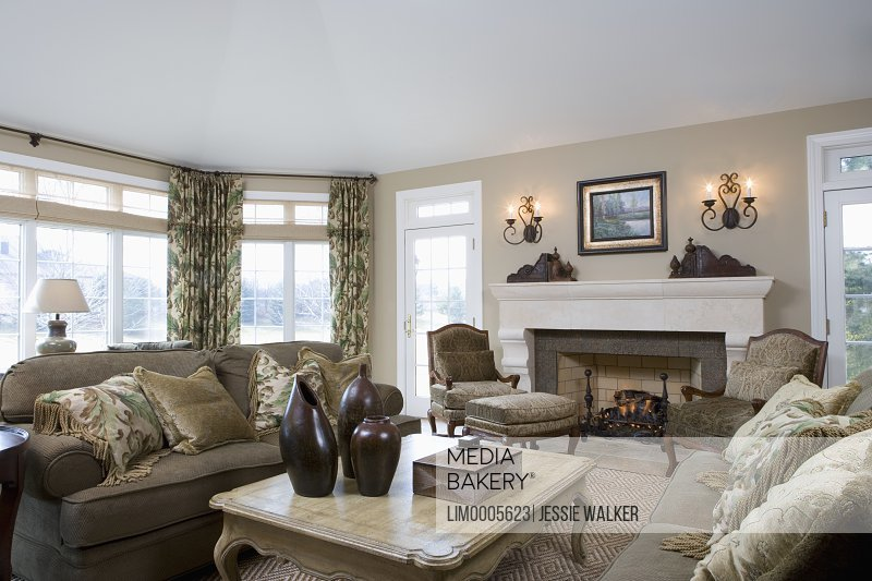Living Room Monochromatic Khaki Sofas Facing Each Other Provincial Coffee Table Bergere Chairs In Front Of Fireplace Bronze Tile Surround