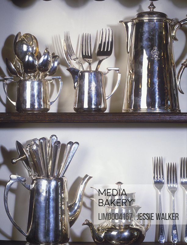 COLLECTION DISPLAY; Detail shot of shelves full of silver vintage Hotel silver service pieces and flatware