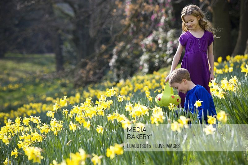 A girl and a boy collecting Easter eggs