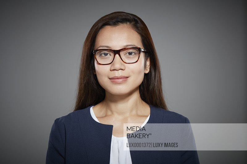 Portrait of mid adult woman wearing glasses.