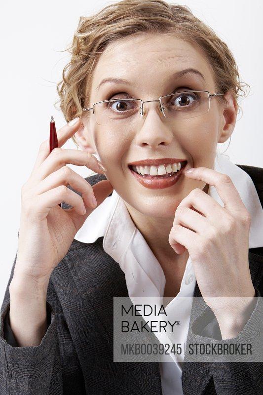 Image of surprised businesswoman in eyeglasses looking at camera