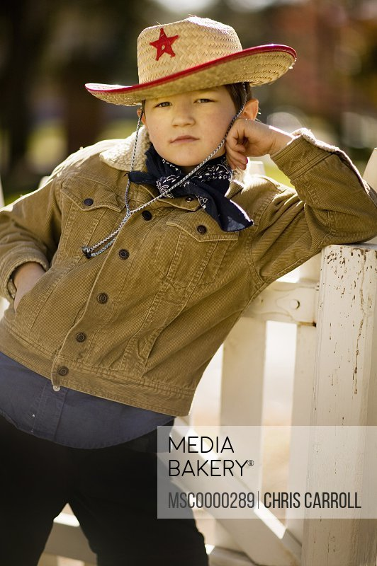 Young boy in cowboy outfit