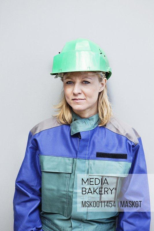 Woman in green helmet