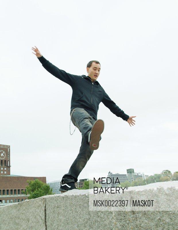 Guy falling off wall
