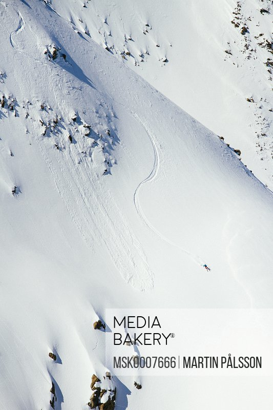 High angle view of man skiing on mountain slope