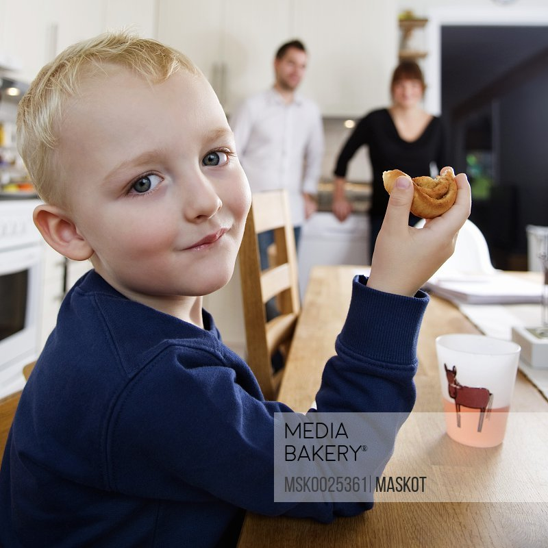 Boy eating bun