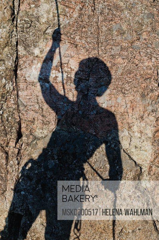 Shadow of a rock climber
