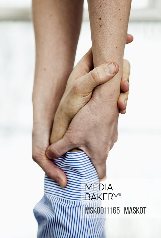 Closeup on helping hands